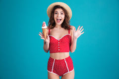 Happy surprised young woman with ice-cream Stock Photography