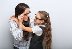 Happy surprising mother and excite kid in fashion glasses looking each other and cuddling royalty free stock photos