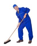 Happy Sweeper Cleaning Floor. On White Background Royalty Free Stock Photography