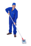Happy Sweeper Cleaning Floor Royalty Free Stock Images