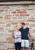Happy Sweet Couple with Skateboard Against Wall Stock Photos