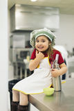 Happy sweet girl cooking. Royalty Free Stock Photos