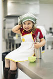 Happy sweet girl cooking. Royalty Free Stock Photography