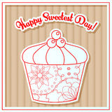 Happy sweetest day card with cupcake on cardboard Royalty Free Stock Photos