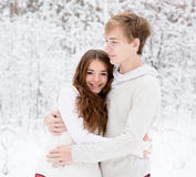 Happy sweethearts embracing Stock Photos