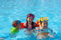 Happy Swimmers in Pool Royalty Free Stock Photography