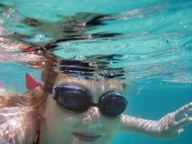 Happy swimming girl. Swimming pretty girl under water royalty free stock photo
