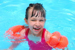 Happy swimming girl Stock Images