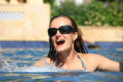 Happy swimming woman. In pool Royalty Free Stock Photos