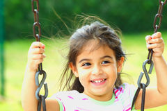 Happy on a Swing Royalty Free Stock Photo