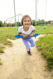 Happy on swing. Girl child (three years old) on a swing in the park Stock Images