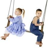 Happy Swinger, Worried Swinger Stock Image