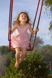 Happy swinging Royalty Free Stock Images