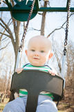 Happy Swinging  Baby Stock Images