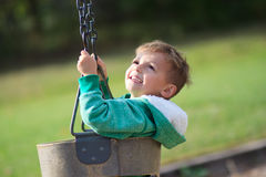 Happy swinging boy royalty free stock images