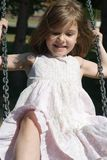Happy swinging on the playground Stock Photography
