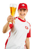 Happy Swiss sports fan cheering with beer. Photo of a Swiss sports fan holding a beer and cheering for her team isolated over white background Royalty Free Stock Photos
