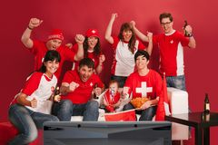Happy Swiss sports fans royalty free stock image