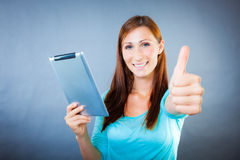 Happy tablet user. Happy pad user laughing smiling blue isolated Royalty Free Stock Photo