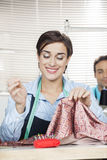 Happy Tailor Stitching Fabric In Factory Stock Image