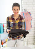 Happy tailor woman showing fabric Stock Image