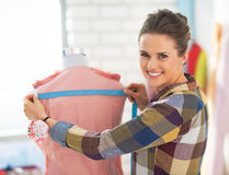 Happy tailor woman working with dress Royalty Free Stock Photos