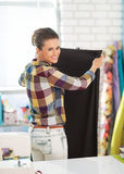 Happy tailor woman working with fabric Royalty Free Stock Images