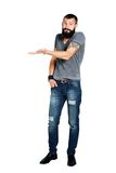 Happy Tattooed bearded man presenting and showing. With copy space for your text isolated on white background Stock Photos