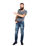 Happy Tattooed bearded man presenting and showing. With copy space for your text isolated on white background Royalty Free Stock Photos