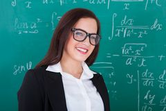 Happy Teacher Against Chalkboard Stock Photo