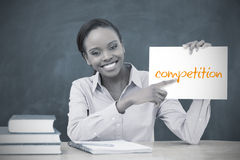 Happy teacher holding page showing competition Stock Image
