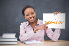 Happy teacher holding page showing seminar Stock Images