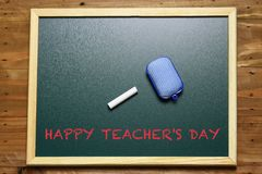 Happy Teacher`s Day. Signage happy teacher`s day on green chalkboard Royalty Free Stock Images