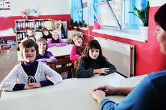 Happy teacher in  school classroom Royalty Free Stock Photo