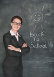 Happy teacher and smiling sun on the chalkboard Stock Photography