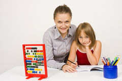 Happy teacher and student in school Royalty Free Stock Photography