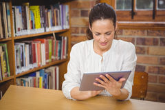 Happy teacher using her tablet pc Stock Image