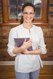 Happy teacher using her tablet pc Royalty Free Stock Photography