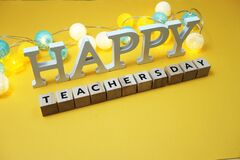 Happy Teachers Day alphabet letter with LED cotton balls on yellow background