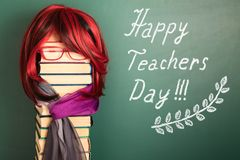 Happy teachers day funny concept with Beauty Teacher Girl. Happy teachers day funny concept with Beautiful Teacher Girl with Luxurious Red Hair royalty free stock images