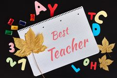Happy Teachers' Day greeting card. Text Best Teacher and school supplies stock image