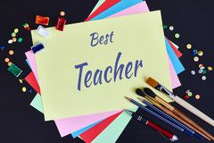 Happy Teachers' Day greeting card. Text Best Teacher and school supplies stock photo