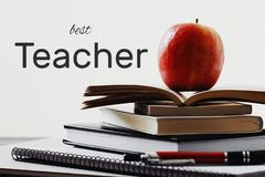 Happy Teachers' Day greeting card. Text Best Teacher and school supplies on white background stock photos