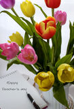 Happy teachers day, handmade tulip flower. Happy teachers day with handmade tulip flower pot, stack of books, pen, message for teacher in special day of royalty free stock image