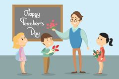 Happy teachers day. Smiling students and teacher with flowers Stock Photos