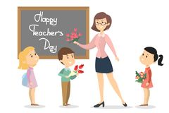Happy teachers day. Smiling students and teacher with flowers Stock Photo