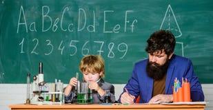 Happy teachers day. School knowledge. Teacher bearded man and boy chemical laboratory. Knowledge day. Basic level stock photography