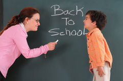 Happy teaching. Preschooler with his teacher in the classroom Stock Image