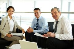 Happy team. Portrait of happy team looking at camera at workplace Royalty Free Stock Images