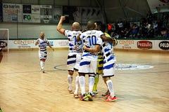 Happy team. Acqua & sapone futsal team is celebrating a goal in the italian match feldi eboli acqua & sapone Royalty Free Stock Photography